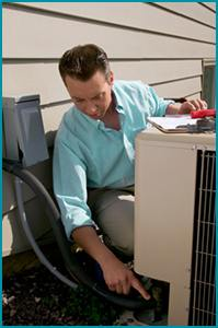 HVAC contractor tuning an air conditioning unit.